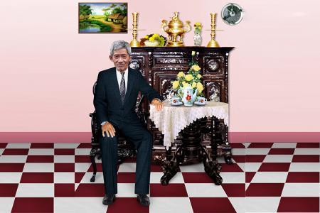 Share PSD ông mặc vest ngồi bàn trà